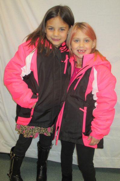 1 - 2 girls in pink coats