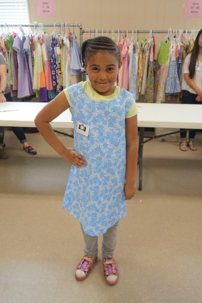 1 - Young girl proud of new blue dress