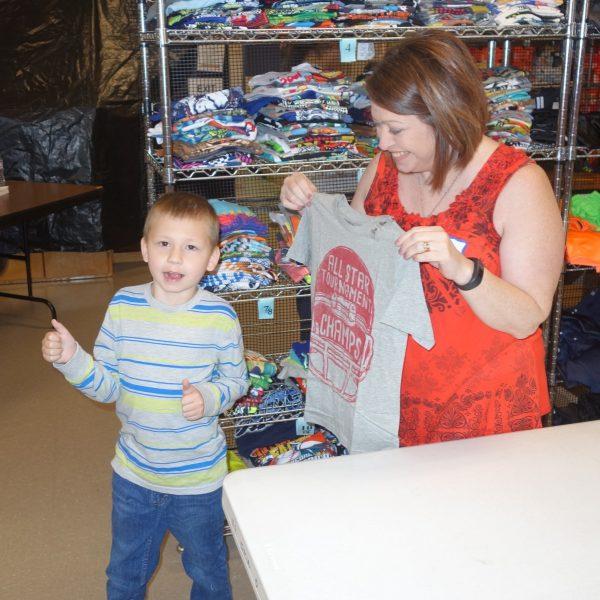 10 - A volunteer helping a little boy