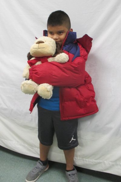 10 - Little boy with his new coat and stuffed animal