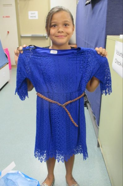 11 - Girl happy with her new blue dress