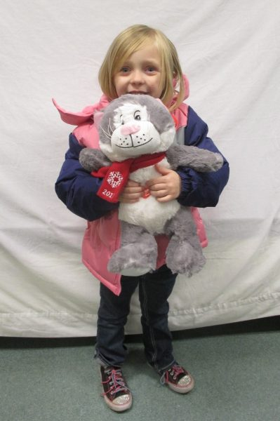 11 - Little girl with her new coat and stuffed animal