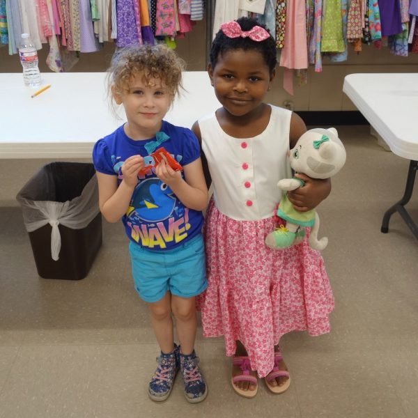 11 - Two girls happy to pick out new clothes