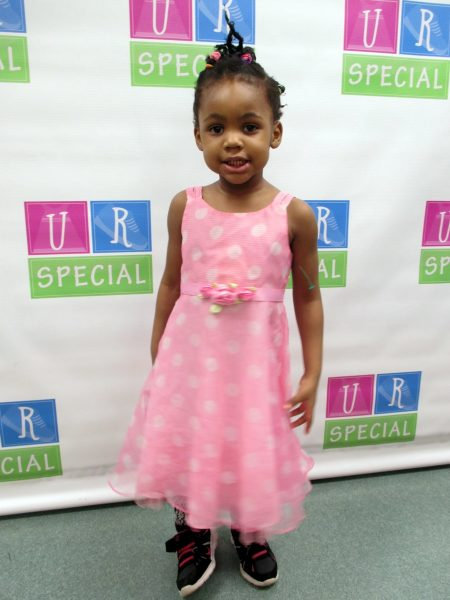 11 - Young girl with her new pink dress