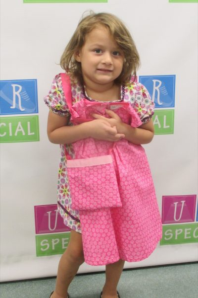 12 - Little girl with her new pink dress