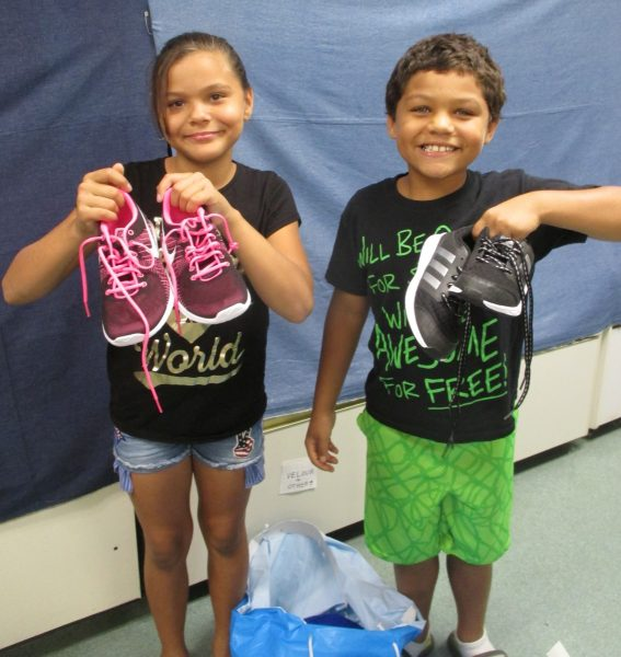 12 - Siblings proud of their new shoes