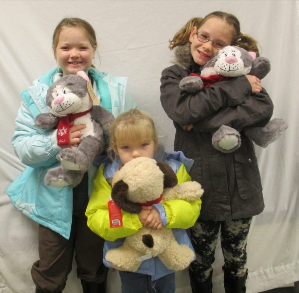 13 - 3 sisters with their new coats and stuffed animals