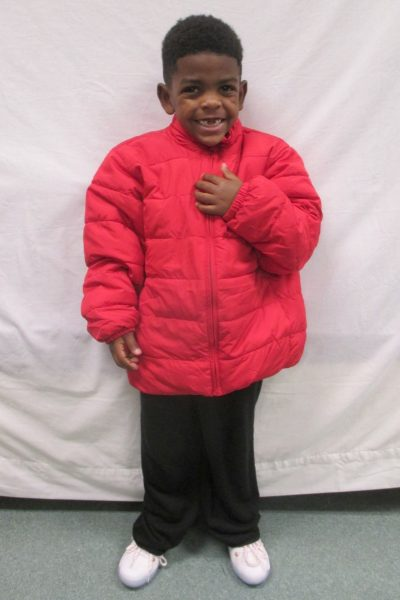14 - Proud little boy with his new red coat