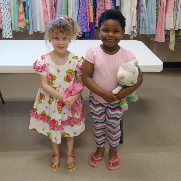 14 - Two girls happy to get new clothes