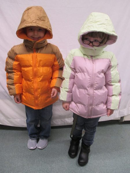 15 - 2 siblings with their new coats