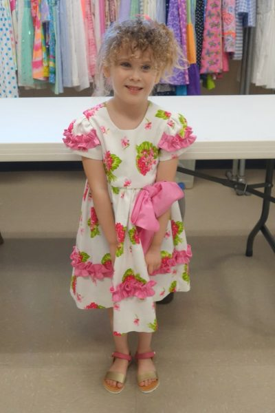 15 - A little girl with her new dress