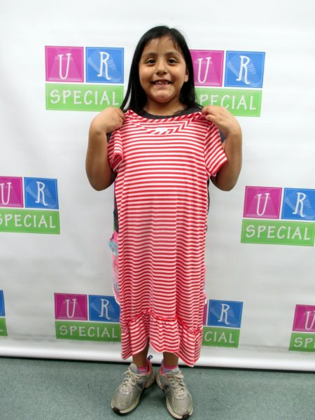 15 - Young girl with her new dress