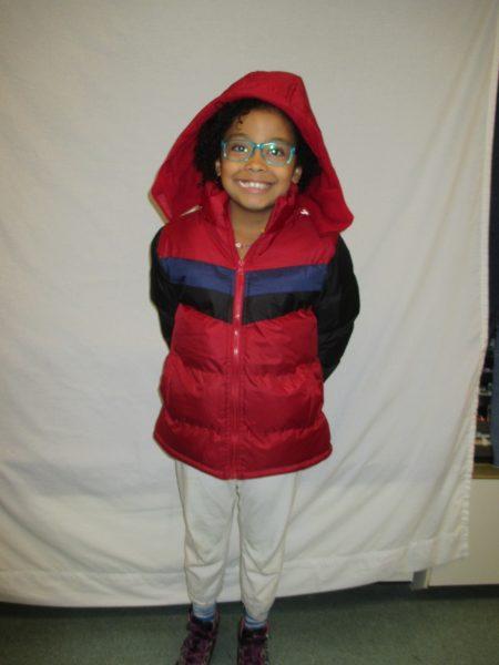 16 - Proud child with new coat