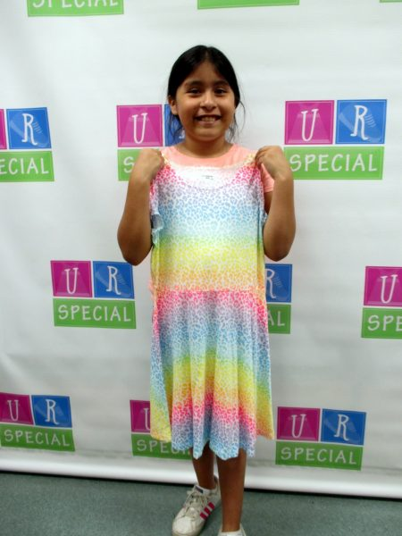 16 - Proud young girl with her new dress