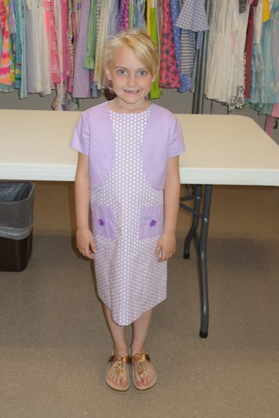 18 - A girl with her new purple dress