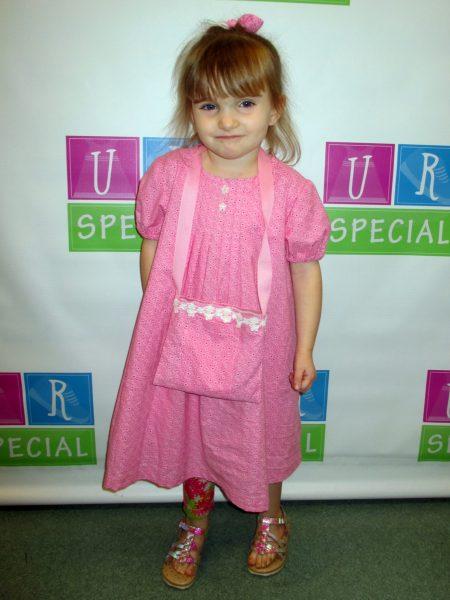 24 - Little girl wearing her new pink dress