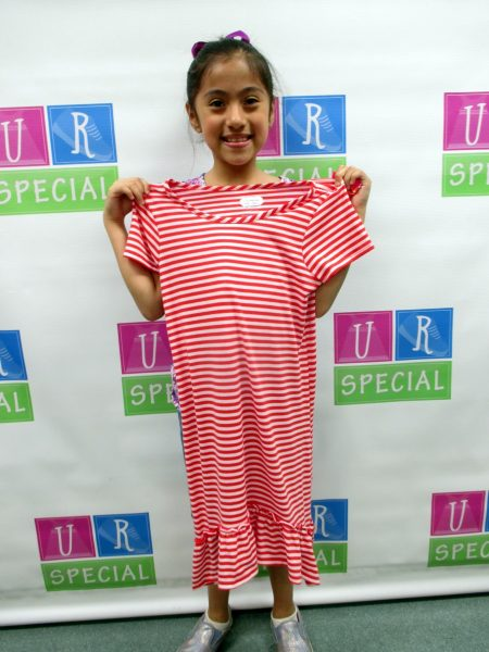 27 - Girl poses proudly with red and white striped dress