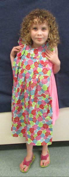 5 - Little girl with her new flower dress