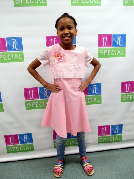 5 - Young girl with her new pink dress
