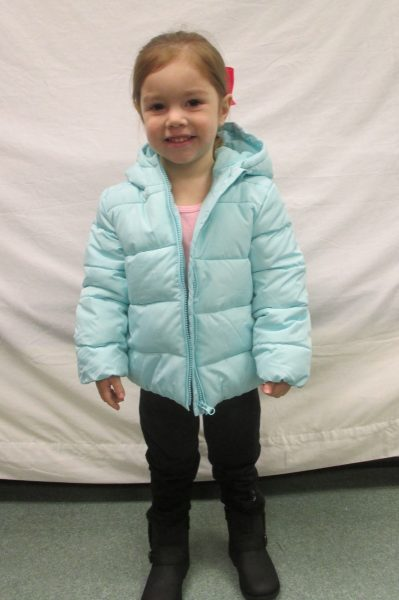 6 - Little girl in her new blue coat