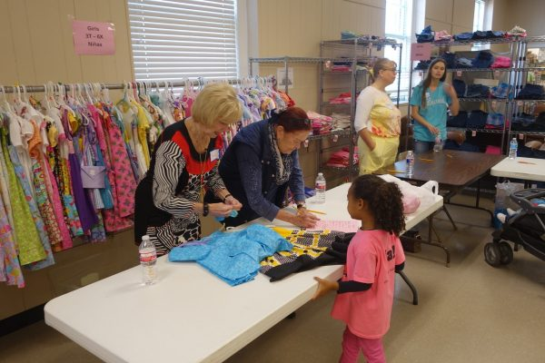 6 - Volunteers helping a young girl