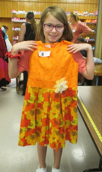 7 - Proud girl with her new orange flower dress