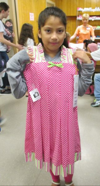 8 - Girl with her new pink polka dot dress