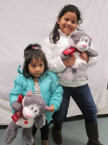 9 - Sisters with their new coats and stuffed animals