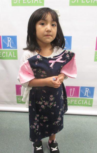 A girl shows off her news dress