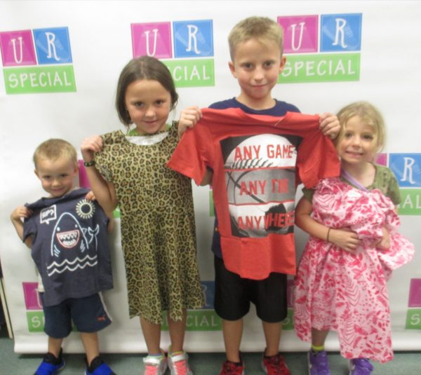 Four siblings show off their new clothes
