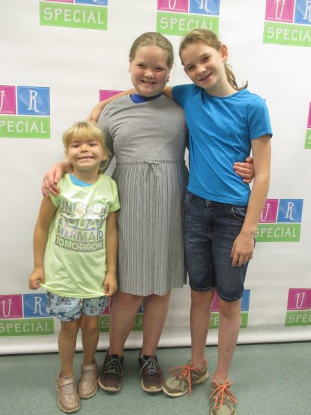 Three sisters with their new clothes