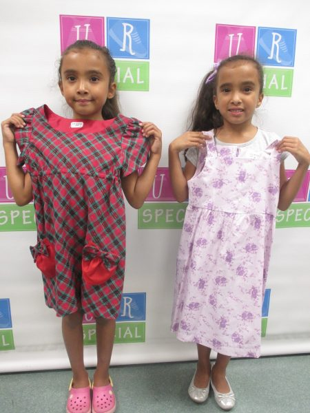 Two girls show off their dresses