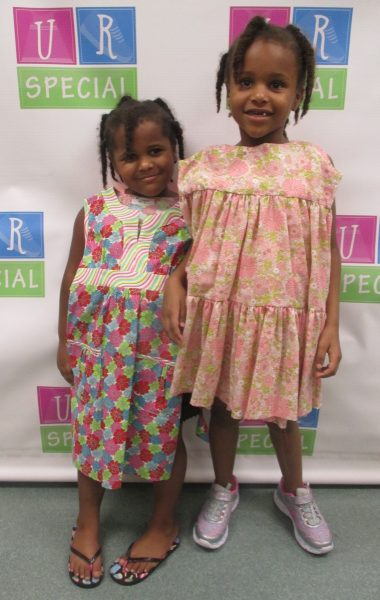 Two girls with their dresses